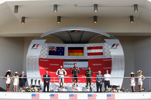 2014 Porsche Supercup. Sunday 2 November 2014. Michael Ammermuller, No.4 Lechner Racing Team, 1st Position, Earl Bamber, No.19 Fach Auto Tech, 2nd Position, and Philipp Eng, No.12 Team Project 1, 3rd Position, on the podium.  World Copyright: /LAT Photographic. ref: Digital Image _89P8515