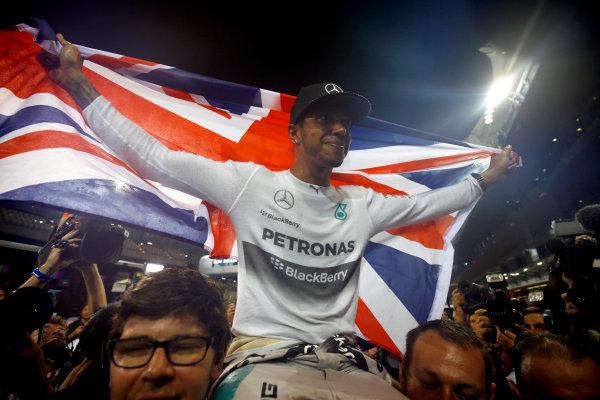 Yas Marina Circuit, Abu Dhabi, United Arab Emirates. Sunday 23 November 2014. Lewis Hamilton, Mercedes AMG, 1st Position, celebrates 2014 title success with his team. World Copyright: Andy Hone/LAT Photographic. ref: Digital Image _ONY2514