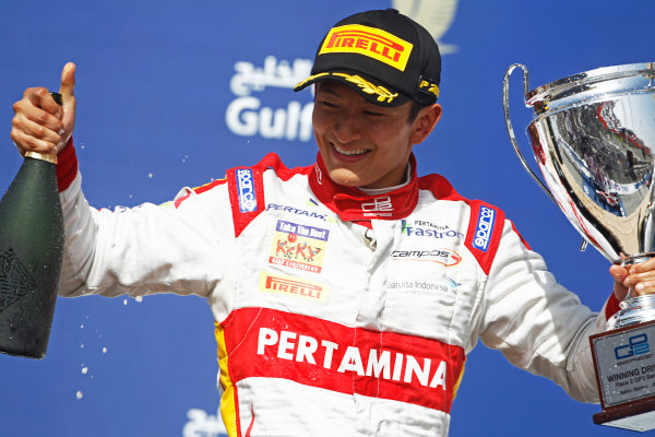 2015 GP2 Series Round 1 - Bahrain International Circuit, Bahrain. Sunday 19 April 2015. Rio Haryanto (INA, Campos Racing) celebrates his win on the podium. Photo: Sam Bloxham/GP2 Series Media Service. ref: Digital Image _G7C9003