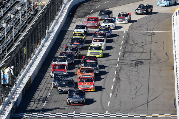 1-2 April, 2016, Martinsville, Virginia USA Kyle Busch (18) leads the field to the green on a restart. ?2016, John Harrelson / LAT Photo USA