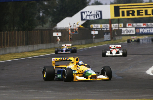 1992 Mexican Grand Prix. Mexico City, Mexico. 20th - 22nd March 1992. Michael Schumacher (Benetton B191B-Ford), 3rd position,  followed by Ayrton Senna (McLaren MP4/6B-Honda), retired and Nigel Mansell (Williams FW14B-Renault), 1st position, action.  World Copyright: LAT Photographic.