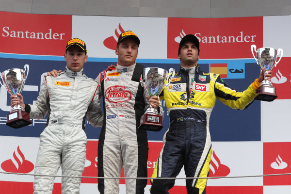2013 GP2 Series. Round 3.  Circuit de Catalunya, Barcelona Spain. 12th May 2013. Sunday Race. Stefano Coletti (MON, Rapax) celebrates his victory on the podium with Robin Frijns (NED, Hilmer Motorsport) and Felipe Nasr (BRA, Carlin). World Copyright: Malcolm Griffiths/GP2 Series Media Service. Ref: C76D6047