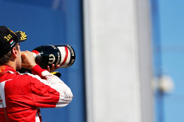 Hungaroring, Budapest, Hungary. Sunday 26 July 2015. Sebastian Vettel, Ferrari, 1st Position, downs Champagne on the podium. World Copyright: Sam Bloxham/LAT Photographic ref: Digital Image _SBL8356