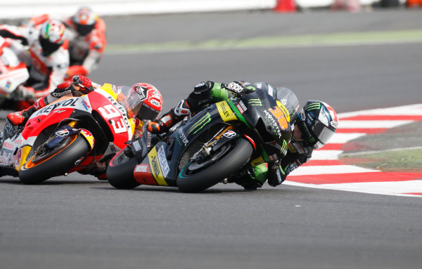 2015 MotoGP Championship.  British Grand Prix.  Silverstone, England. 28th - 30th August 2015.  Bradley Smith, Tech 3 Yamaha, and Marc Marquez, Honda.  Ref: KW7_6162a. World copyright: Kevin Wood/LAT Photographic