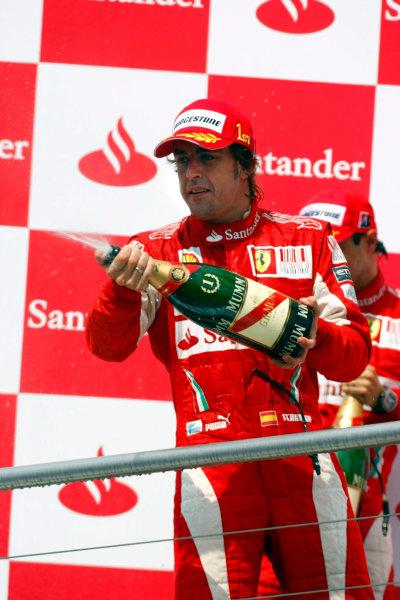 Hockenheimring, Hockenheim, Germany25th July 2010Fernando Alonso, Ferrari F10, 1st position, sprays the Champagne on the podium. Portrait. Podium. World Copyright: Charles Coates/LAT Photographicref: Digital Image _26Y6077