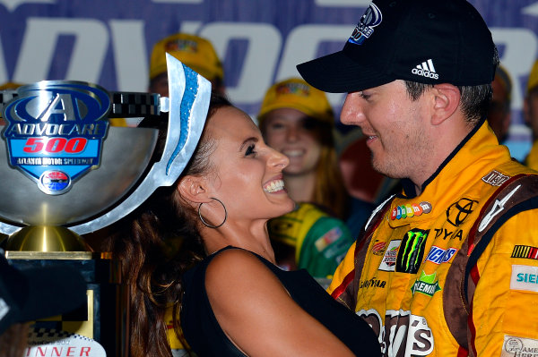 August 30 - September 1, 2013, Hampton, Georgia USA Samantha and Kyle Busch, M&M's Toyota Camry in Victory Lane © 2013, Brian Czobat LAT Photo USA