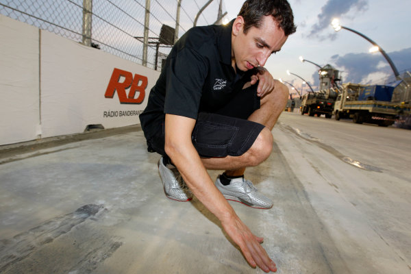 13-14 March, 2010, Sao Paulo, BrazilJustin Wilson inspects the results of the pavement grinding©2010, Michael L. Levitt, USALAT Photographic