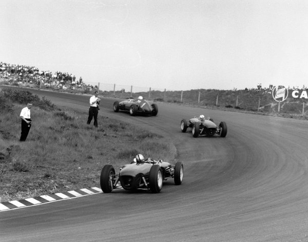 1960 Dutch Grand Prix. Zandvoort, Holland. 6th June 1960. Alan Stacey (Lotus 18-Climax), retired, chases Phil Hill (Ferrari 246 Dino), retired, action.  World Copyright: LAT Photographic. Ref: 6585.