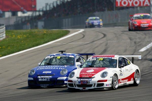 2006 European Grand Prix - Porsche Supercup Nurburgring, Germany. 4th - 7th May 2006 Michael Bleekemolen leads Colin McRae, action. World Copyright: Glenn Dunbar/LAT Photographic ref: Digital Image YY8P0344