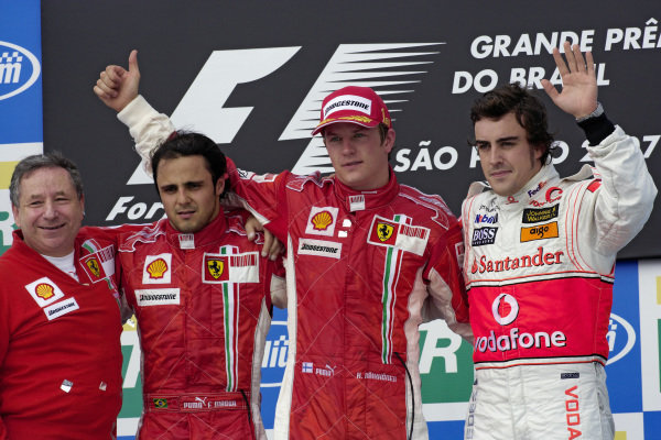 Podium group photo: Ferrari's team principal Jean Todt with 2nd placed Felipe Massa, winner Kimi Raikkonen and 3rd placed Fernando Alonso.
