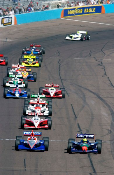 IRL IndyCar Series Purex Dial Indy 200 21-23 March,2003, Phoenix International Speedway, Phoenix, AZ, USAFelipe Giaffone (21) takes the lead from Roger Yasukawa at the start/finish line.World Copyright-F Peirce Williams 2003 LAT Photographic(ref: Digital Image Only)