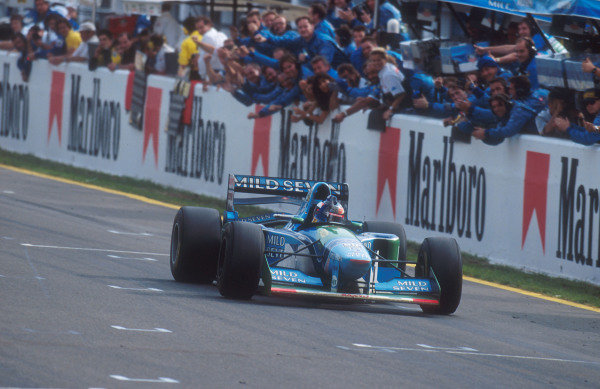 1994 European Grand Prix.Jerez, Spain.14-16 October 1994.Michael Schumacher (Benetton B194 Ford) celebrates his win as does the Benetton team.Ref-94 EUR 09.World Copyright - LAT Photographic