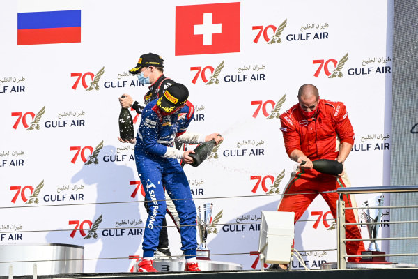 Race Winner Robert Shwartzman (RUS, PREMA RACING), Louis Deletraz (CHE, CHAROUZ RACING SYSTEM) and Winning Constructor Representative celebrate on the podium with the champagne