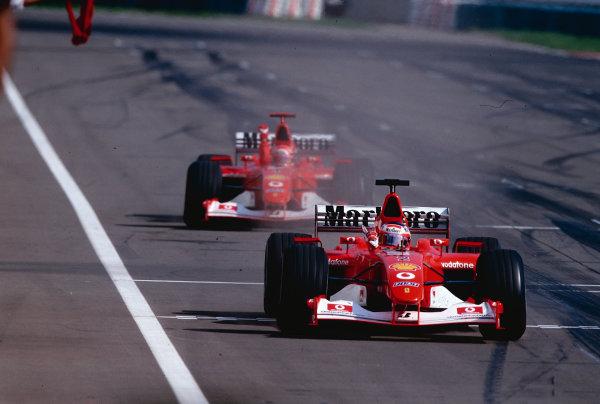 2002 Hungarian Grand Prix.Hungaroring, Budapest, Hungary. 16-18 August 2002.Rubens Barrichello closely followed by team mate Michael Schumacher (both Ferrari F2002's) crosses the finish line to take 1st position. Ref-02 HUN 30.World Copyright - Tee/LAT Photographic