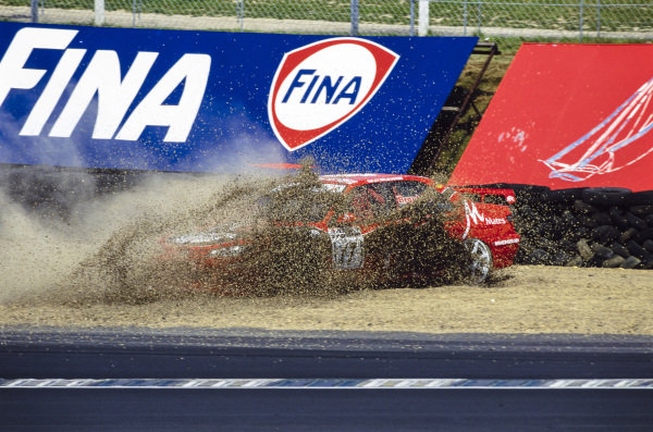 Lee Brookes, Brookes Motorsport, Peugeot 406, spins into the gravel trap