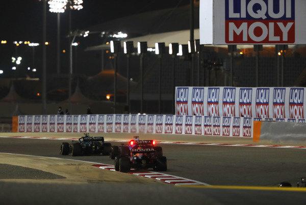 Sebastian Vettel, Aston Martin AMR21, leads Fernando Alonso, Alpine A521, and Sergio Perez, Red Bull Racing RB16B
