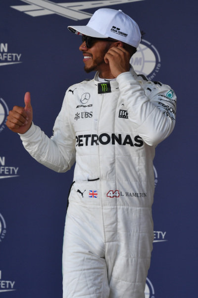 Pole sitter Lewis Hamilton (GBR) Mercedes AMG F1 celebrates in parc ferme at Formula One World Championship, Rd17, United States Grand Prix, Qualifying, Circuit of the Americas, Austin, Texas, USA, Saturday 21 October 2017.