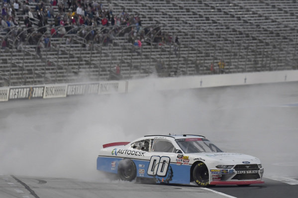 #00: Cole Custer, Stewart-Haas Racing, Ford Mustang Autodesk, does a burnout after winning.