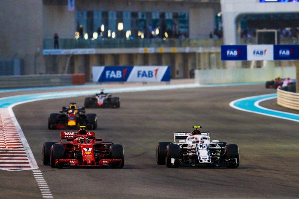 Charles Leclerc, Sauber C37 Ferrari, battles with Kimi Raikkonen, Ferrari SF71H, ahead of Daniel Ricciardo, Red Bull Racing RB14