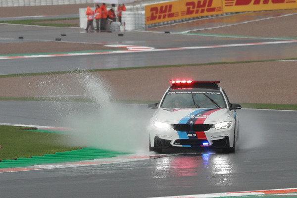 BMW safety car in rain.