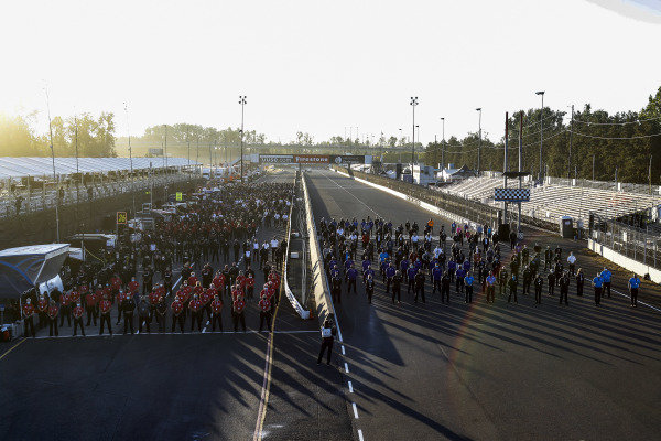 IndyCar teams and staff assemble for a moment of silence tribute to honor 9/11