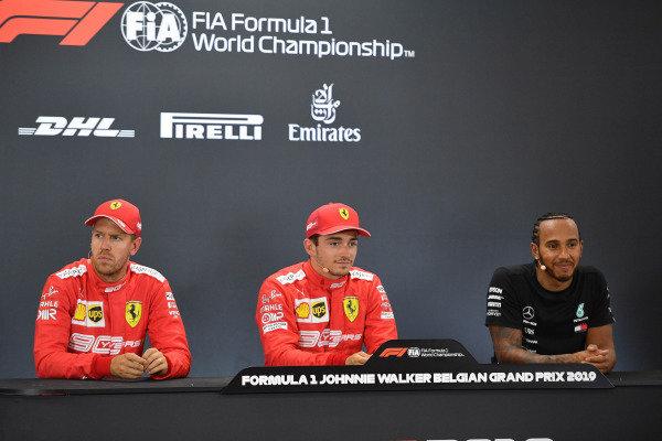 Pole winner Charles Leclerc, Ferrari, sits between Sebastian Vettel, Ferrari and Lewis Hamilton, Mercedes AMG F1
