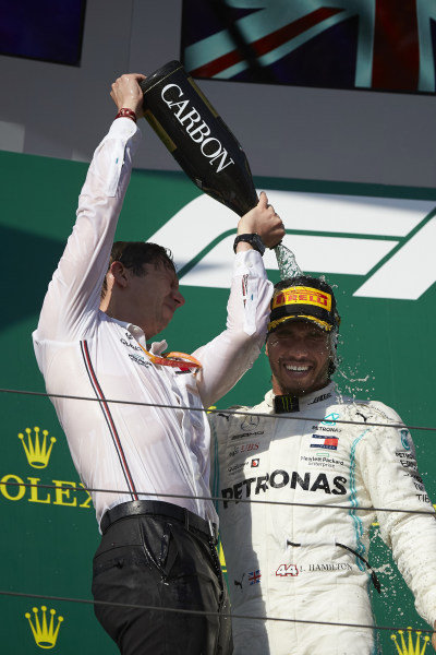 Matt Deane, Chief Mechanic, Mercedes AMG, pours Champagne over Lewis Hamilton, Mercedes AMG F1, 1st position, on the podium