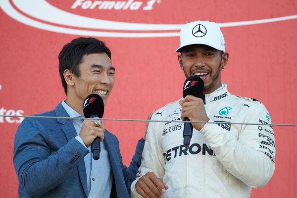 Suzuka Circuit, Japan. Sunday 8 October 2017. Takuma Sato interviews Lewis Hamilton, Mercedes AMG, 1st Position, on the podium. World Copyright: Steve Etherington/LAT Images  ref: Digital Image SNE15027