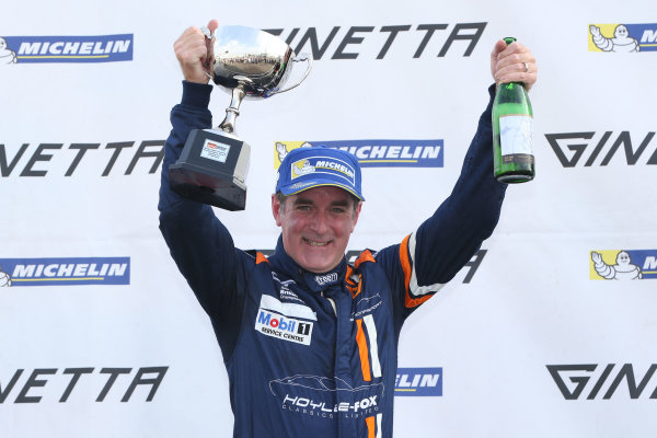 2014 Ginetta GT4 Supercup, Silverstone, England. 27th-28th September 2014. Paul McNeilly (GBR) Fox Motorsport on the Amateur podium. World Copyright: Ebrey / LAT Photographic.