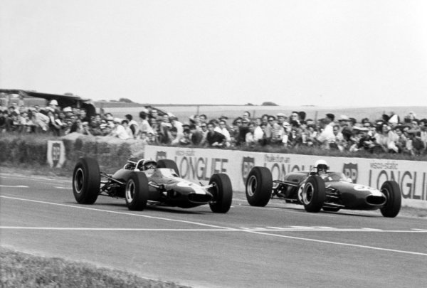 1966 French Grand Prix.Reims, France. 3 July 1966.Pedro Rodriguez, Lotus 33-Climax, retired, left, and Bob Anderson, Brabham BT11-Climax, 7th position, action.World Copyright: LAT Photographic