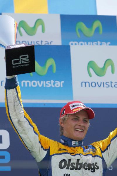 Valencia Spain. 27th June. Sunday Race. Marcus Ericsson (SWE, Super Nova Racing) celebrates his victory on the podium. Portrait.Portrait. Photo: Andrew Ferraro/GP2 Media Service. Ref: _O9T4576 jpg