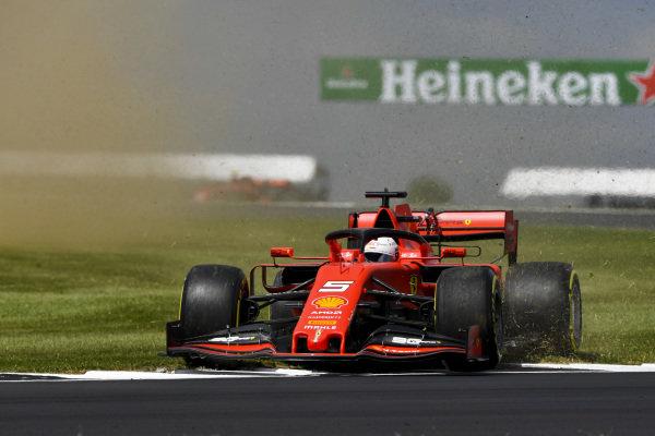 Sebastian Vettel, Ferrari SF90, goes over the grass