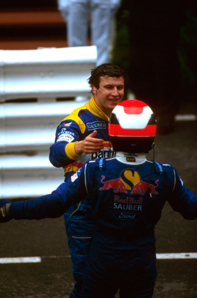 Monte Carlo, Monaco.16-19 May 1996.Olivier Panis (Ligier Mugen-Honda) 1st position, and Johnny Herbert (Sauber Ford) 3rd position celebrate in parc ferme.Ref-96 MON 03.World Copyright - LAT Photographic