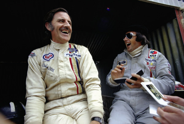 Graham Hill shares a joke with Jackie Stewart during practice.