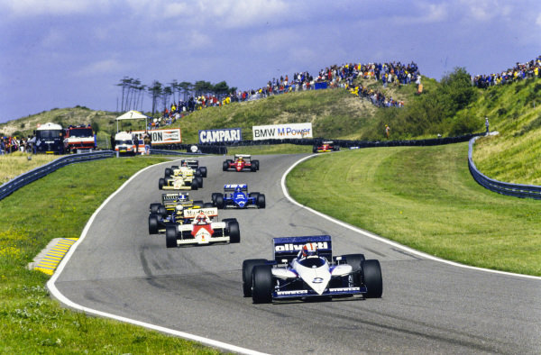 Marc Surer, Brabham BT54 BMW, leads Niki Lauda, McLaren MP4-2B TAG, Elio de Angelis, Lotus 97T Renault, Derek Warwick, Renault RE60B, Jacques Laffite, Ligier JS25 Renault, Gerhard Berger, Arrows A8 BMW, Piercarlo Ghinzani, Toleman TG185 Hart, and Michele Alboreto, Ferrari 156/85.