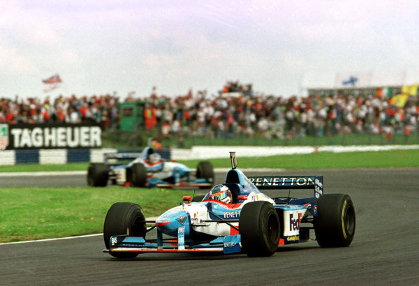 1997 British Grand Prix.Silverstone, England.11-13 July 1997.Jean Alesi leads Alexander Wurz (both Benetton B197 Renault) at Vale. They finished in 2nd and 3rd positions respectively.World Copyright - Coates/LAT Photographic