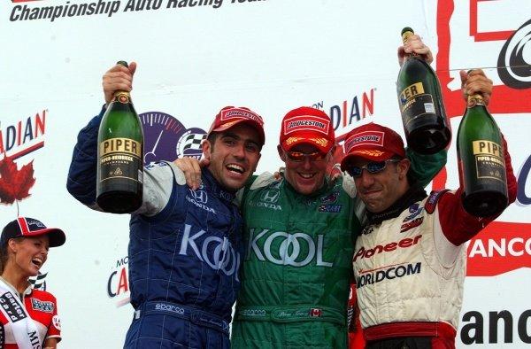 Podium and results: L-R;1st Dario Franchitti (GBR) Team Kool Green.2nd Paul Tracy (CDN) Team Kool Green.3rd Tony Kanaan (BRA) Mo Nunn Racing. CART FedEx World Series, Rd10, Concord Pacific Place, Vancouver, Canada,  28 July 2002.DIGITAL IMAGE