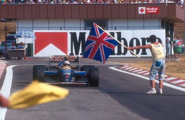1992 Hungarian Grand Prix.Hungaroring, Budapest, Hungary.14-16 August 1992.Nigel Mansell (Williams FW14B Renault) 2nd position, celebrates winning the drivers World Championship.Ref-92 HUN 03.World Copyright - LAT Photographic