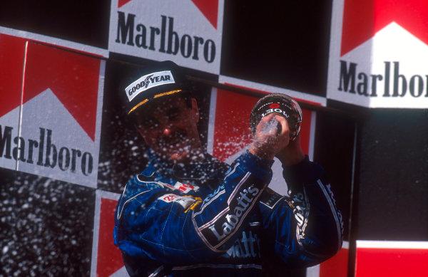 1992 Hungarian Grand Prix.Hungaroring, Budapest, Hungary.14-16 August 1992.Nigel Mansell (Williams Renault) 2nd position, celebrates winning the drivers World Championship on the podium.Ref-92 HUN 10.World Copyright - LAT Photographic