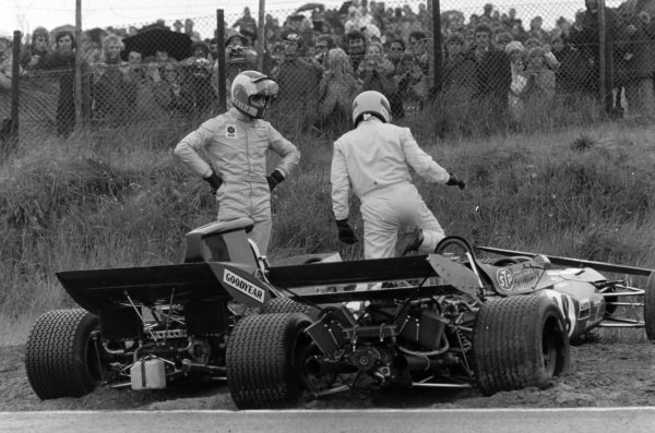 François Cevert, Tyrrell 002 Ford and Nanni Galli, March 711 Alfa Romeo assess the damage to their respective cars after crashing into each other.
