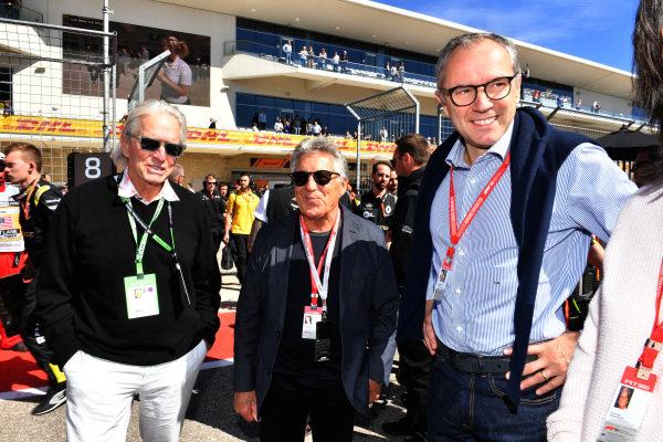 Actor Michael Douglas talks to 1978 world champion Mario Andretti and Stefano Domenicali, CEO of Lamborghini