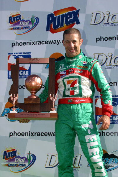 2003 Phoenix IRL IndyCar, 21-23 March 2003; Phoenix International Raceway; Phoenix, Arizona USATony Kanaan with the winner's trophy-2003 Lesley Ann Miller, USALAT Photographic