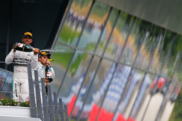 Red Bull Ring, Spielberg, Austria. Sunday 21 June 2015. Lewis Hamilton, Mercedes AMG, 2nd Position, sprays Champagne from the podium. World Copyright: Sam Bloxham/LAT Photographic. ref: Digital Image _SBL7893