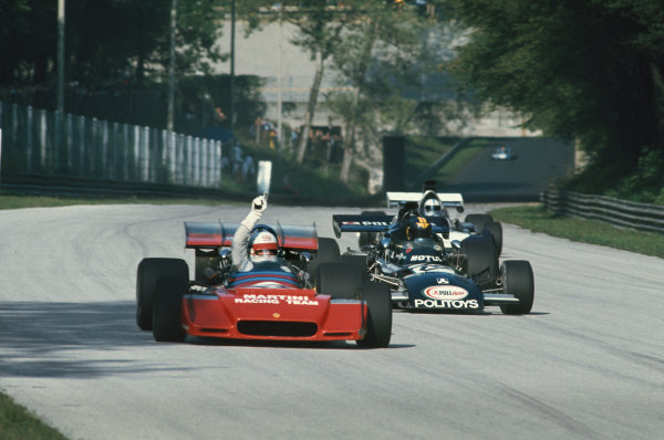 1972 Italian Grand Prix.  Monza, Italy. 8-10th September 1972.  Derek Bell, Tecno PA123, with raised arm ahead of Carlos Pace, March 711 Ford, and John Surtees, Surtees TS14 Ford, in practice.  Ref: 72ITA60. World Copyright: LAT Photographic