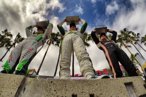 11-13 April, 2014, Long Beach, California USA Mike Conway, Will Power and Carlos Munoz in victory lane ©2014, Lesley Ann Miller LAT Photo USA