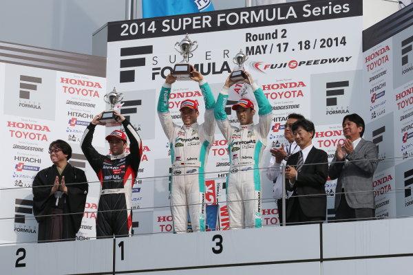 2014 Super Formula Series. Fuji, Japan. 17th - 18th May 2014. Rd 2. Race 2 - Winner Andre Lotterer ( #36 PETRONAS TOM'S SF14 ) 2nd position Joao Paulo de Oliveira ( #19 Lenovo TEAM IMPUL SF14 ) 3rd position Kazuki Nakajima ( #37 TEAM TOM'S SF14 ) podium, portrait World Copyright: Yasushi Ishihara / LAT Photographic. Ref: 2014SF_Rd2_023.JPG