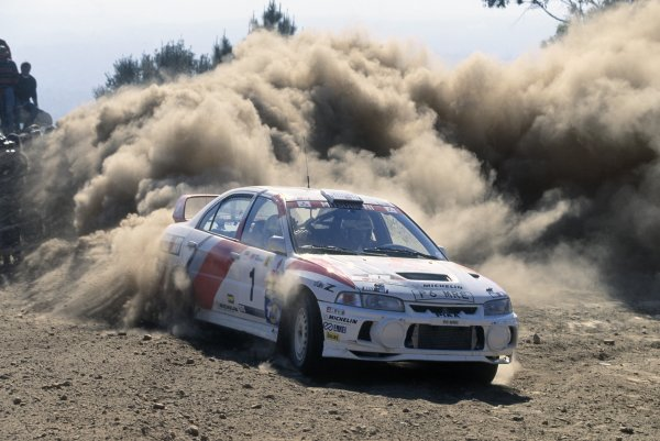 1998 World Rally Championship.Portuguese Rally, Portugal. 23-25 March 1998.Tommi Makinen/Risto Mannisenmaki (Mitsubishi Lancer Evo4), retired.World Copyright: LAT PhotographicRef: 35mm transparency 98RALLY12