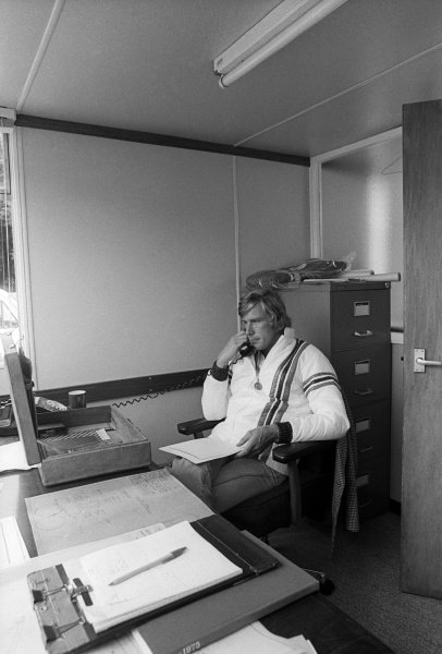 James Hunt (GBR) Hesketh, takes a telephone call at the headquarters of Hesketh Racing. Formula One World Championship, Easton Neston, Towcester, England, c. Summer 1975.