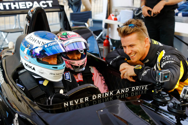 London, United Kingdom.  Wednesday 12 July 2017. Mika Hakkinen takes Sergio Perez, Force India, forn a ride. World Copyright: Steven Tee/LAT Images  ref: Digital Image _O3I9632