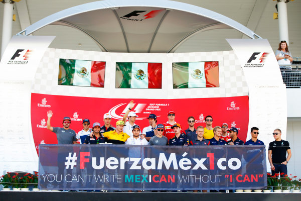 Suzuka Circuit, Japan. Sunday 08 October 2017. Sergio Perez, Force India, and the rest of the drivers take part in an event in support of Mexico on the podium. World Copyright: Andy Hone/LAT Images  ref: Digital Image _ONY8361